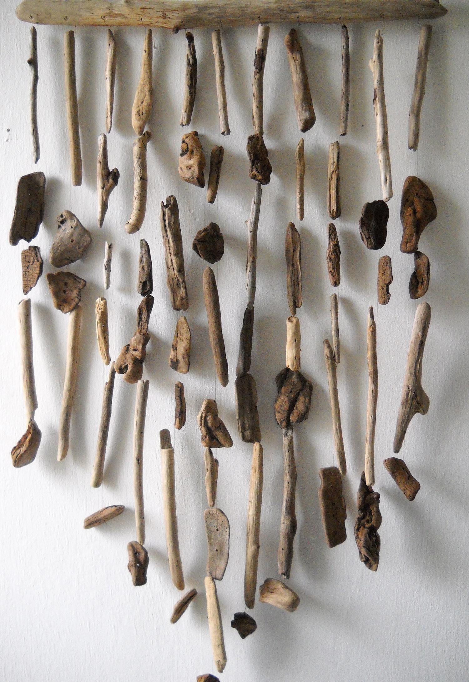 Créations En Bois Flotté un rideau décoratif avec du bois flotté